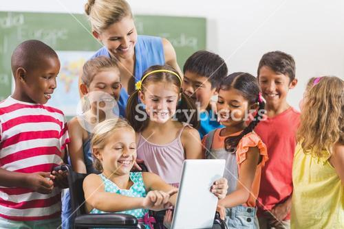 Teacher and kids using digital tablet
