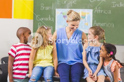 Teacher and kids having fun in classroom