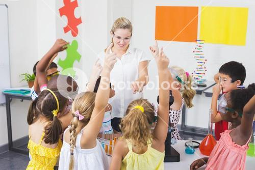 Kids raising hand in laboratory