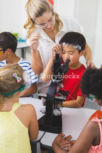 Teacher assisting kids in laboratory