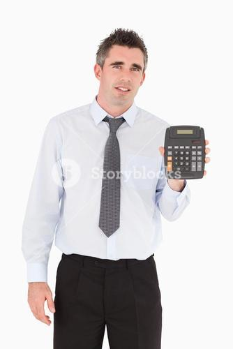 Accountant showing a calculator