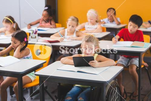 School kids studying in classroom