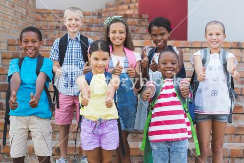 Group of kids standing on staircase showing thumbs up