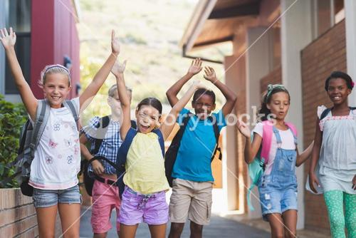 Group of kids standing in a row at school campus