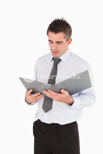 Portrait of a man looking at a binder