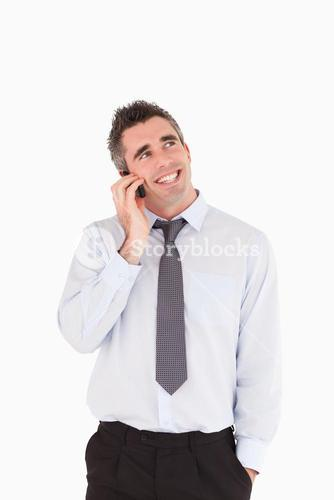 Portrait of a smiling man making a phone call