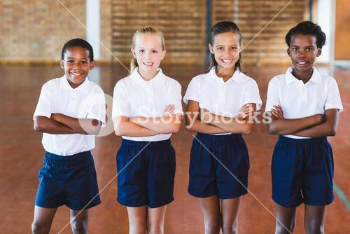 Portrait of school kids standing with arms crossed