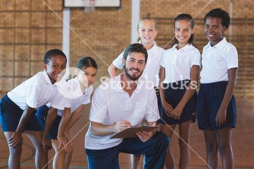 Portrait of sports teacher and school kids