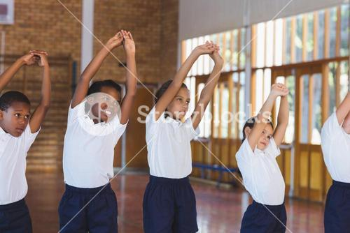 School kids exercising in basketball court