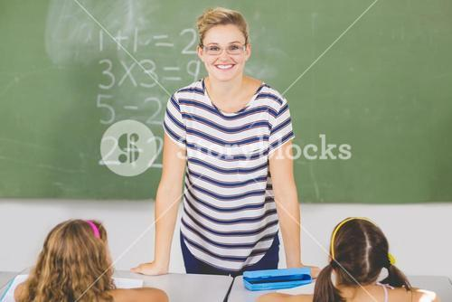 Teacher in mathematics class