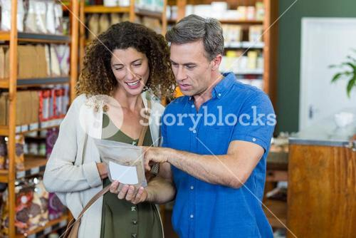 Couple shopping together for groceries