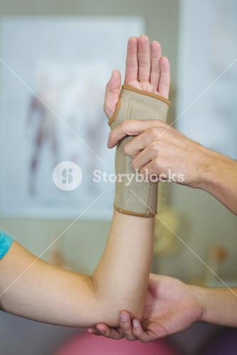 Physiotherapist examining a woman wrist