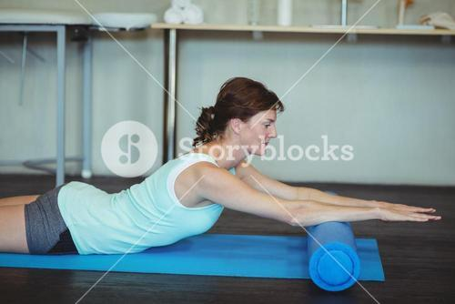 Woman performing stretching exercise on mat