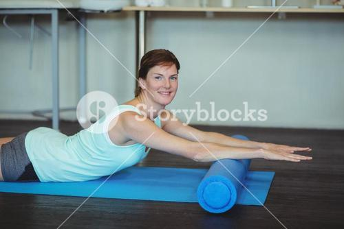 Portrait of woman performing stretching exercise