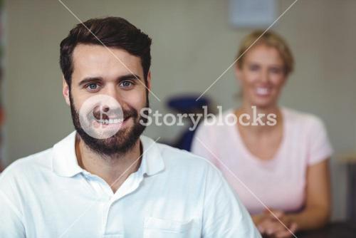 Male therapist smiling in clinic