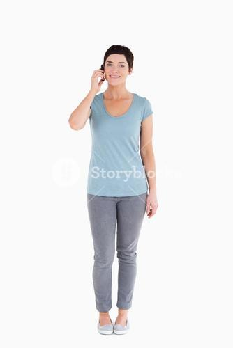 Serene woman answering the phone