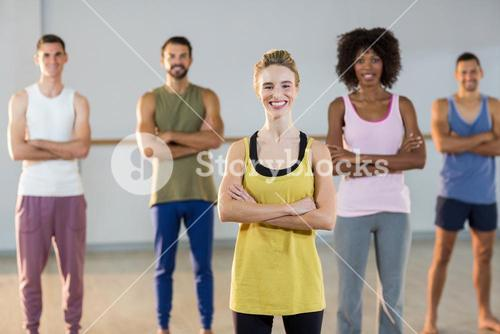 Portrait of group of people standing in gym