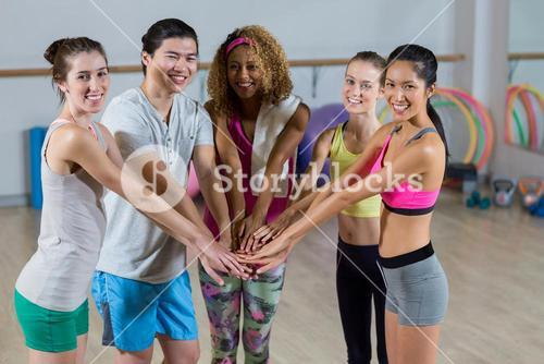 Group of fitness team with hand stacked