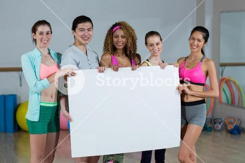 Group of fitness team holding blank placard