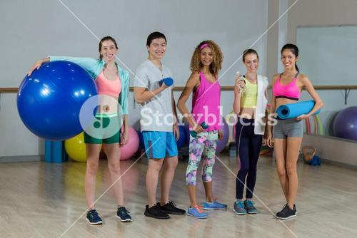 Group of fitness team standing in fitness studio