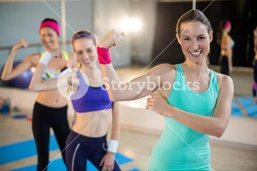Group of women showing biceps