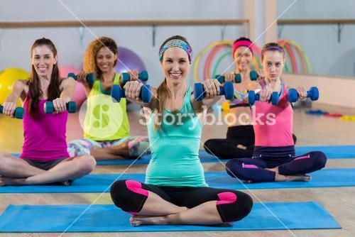 Group of women exercising with dumbbell