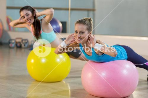 Two women exercising on exercise ball