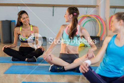 Group of women talking while exercising