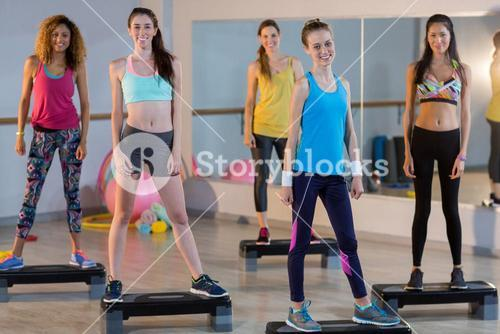 Group of women standing on aerobic stepper