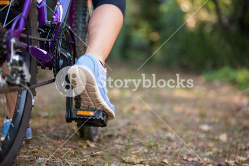 Female cyclist cycling in countryside