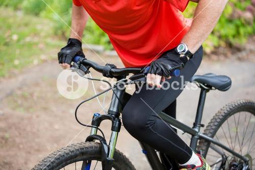Male cyclist cycling in countryside