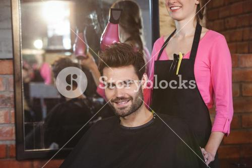 Hairdresser styling customers hair