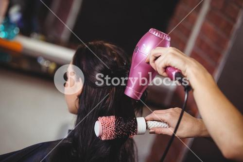 Woman getting her hair dried