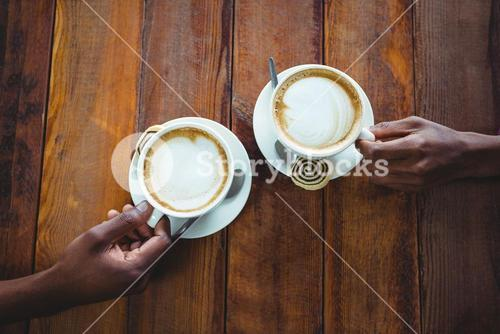 Couple hand holding cup of coffee