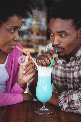 Young couple having mocktail
