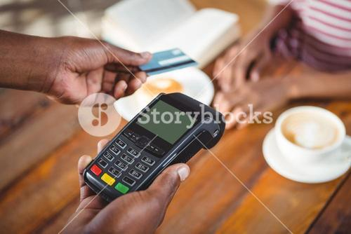 Waiter holding credit card machine