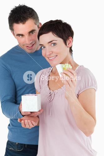 Portrait of a man surprising his fiance with a present