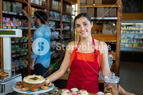 Woman standing near confectionery section