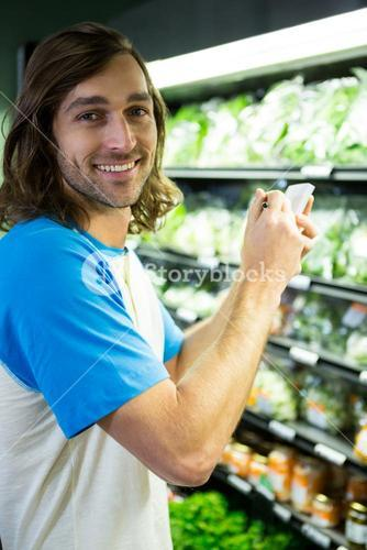 Man ticking on shopping checklist