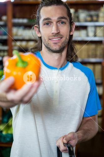 Man holding bell pepper