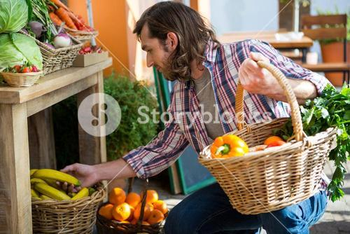 Man buying fruits and vegetables in organic shop