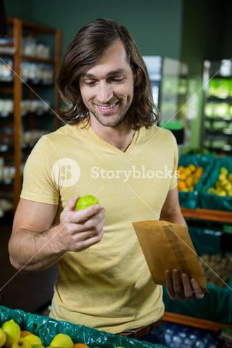 Man holding lemon in supermarket