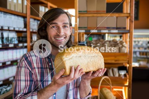 Man holding a loaf of bread