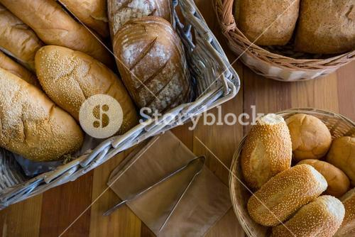 Close-up of various breads on display counter