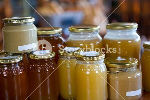 Jars of honey and nut butters on display shelf