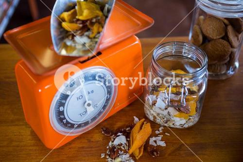 Dried fruits and nuts on weighing machine