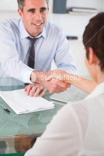Portrait of a manager and an applicant having a handshake