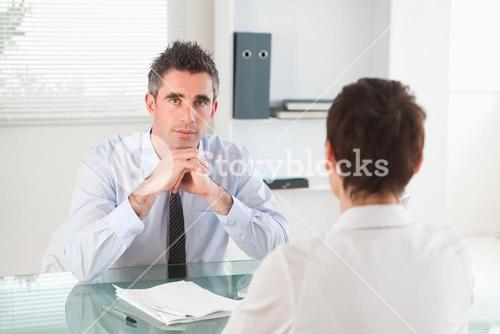Serious manager interviewing a female applicant