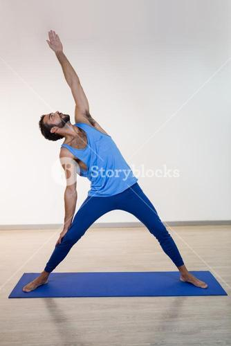 Man doing extended triangle pose