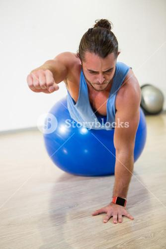 Man exercising on exercise ball